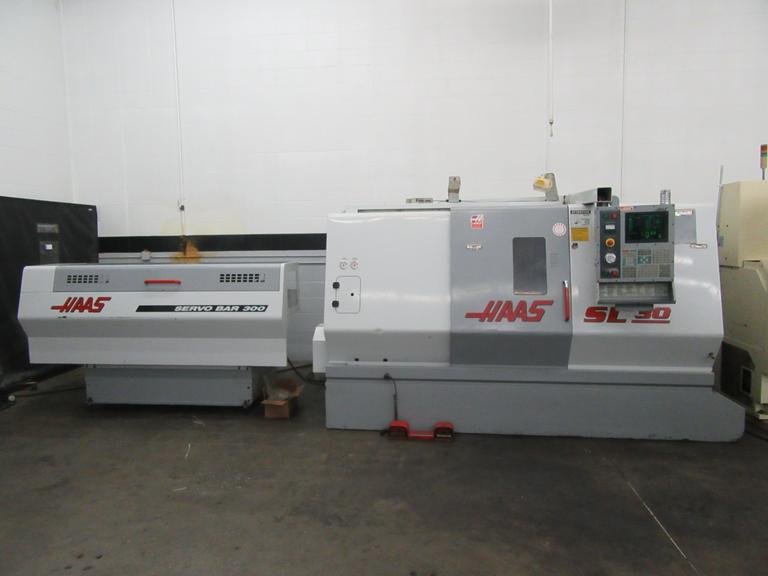 Haas SL-30 CNC Turning Center with Tailstock and Haas Servobar 300 Magazine Bar Feed