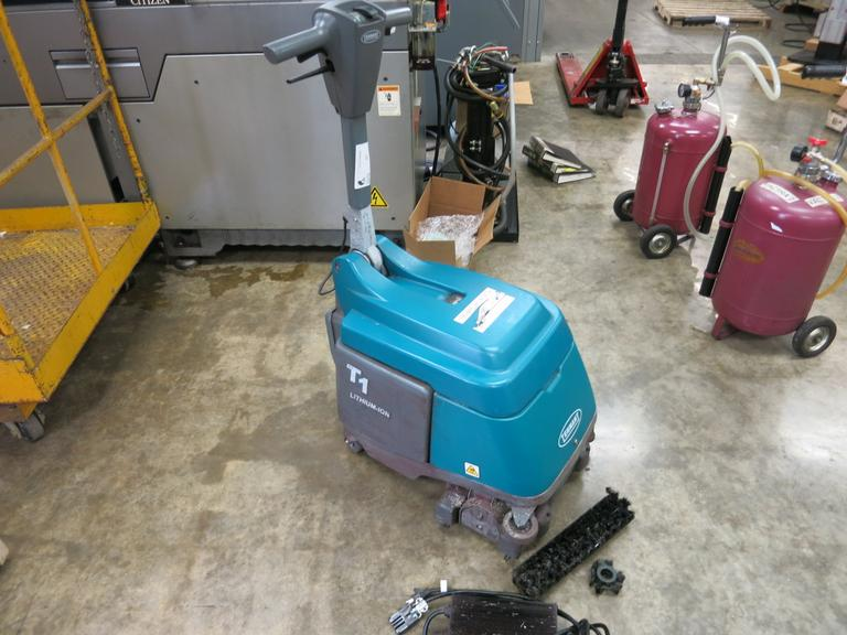 Tennant Model T1 Lithium Ion Walk Behind Floor Scrubber with Charger.  2773 Hours on Meter.
