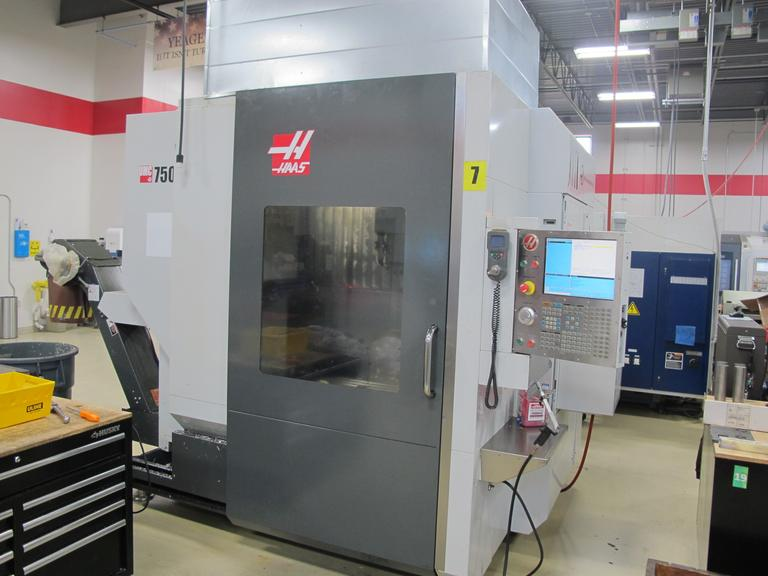 Haas UMC-750SS 5-Axis Vertical Machining Center with Through Spindle Coolant, Renishaw Wireless Tool and Parts Probing System, and High Speed Machining.