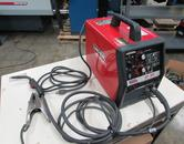 Lincoln SP-100 Arc Welding Power Source and Wire Feeder with MIG Gun and Ground Clamp