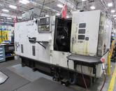 Murata Warner & Swasey M-5130 CNC Chucker with Fanuc OT CNC Control and Chip Conveyor